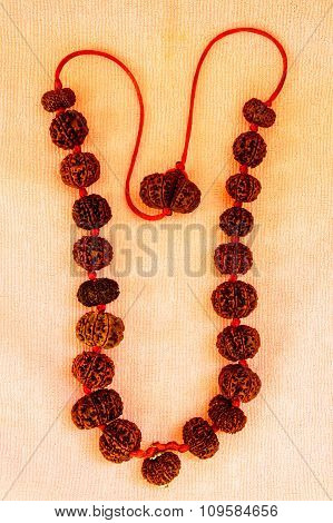 Powerful rudraksha combination mala kept on a plain cloth background