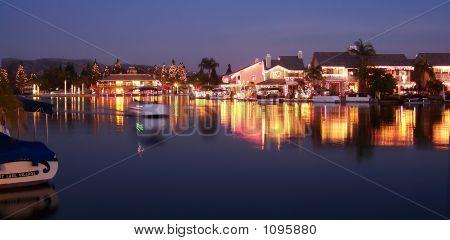 Boating On Lake With Christmas Lights