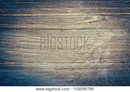 closeup of grunge and gritty blue painted, rough wood background