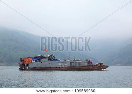 A cargo ship running on Song Da hydro-power lake