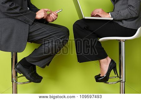 Close Up Of Business People Using Laptop And Mobile Phone