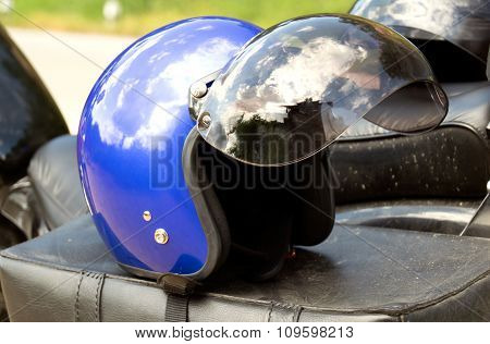 Blue helmet Put on the seat of a motorcycle chopper