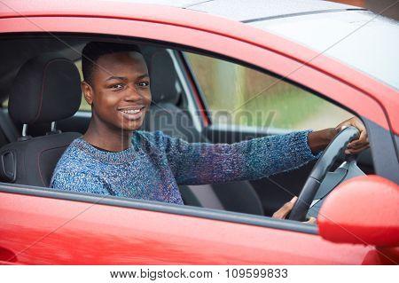 Newly Qualified Teenage Boy Driver Sitting In Car