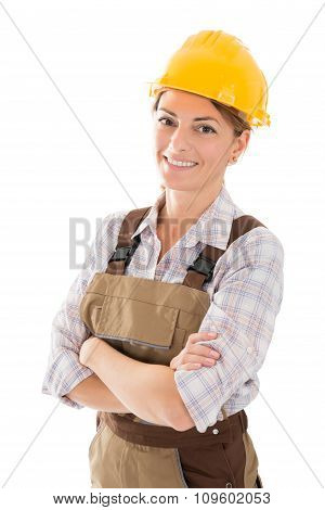 Portrait Of Smiling Female Worker Standing Arms Crossed
