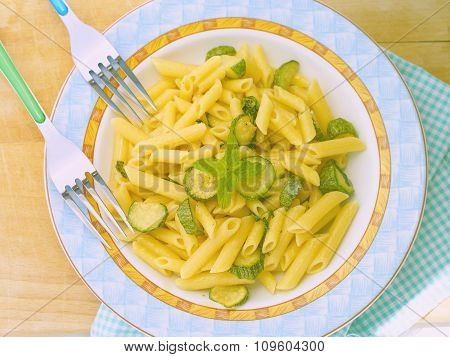 Pasta penne with coooked zucchini and mint