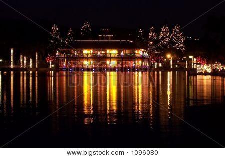 Christmas Lights Of Lodge Reflecting On Lake