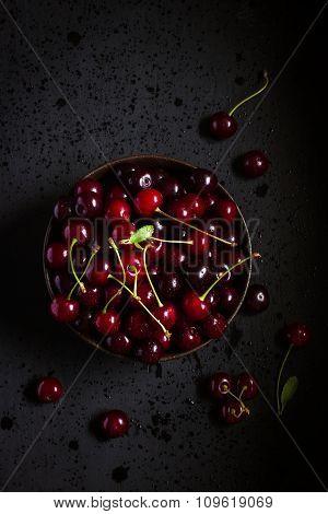 Fresh Cherry In Black Bowl