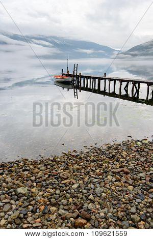 Boat near wooden pier in a norwegian lake