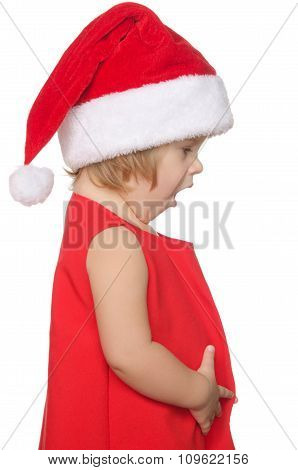 Surprised Child In Christmas Cap