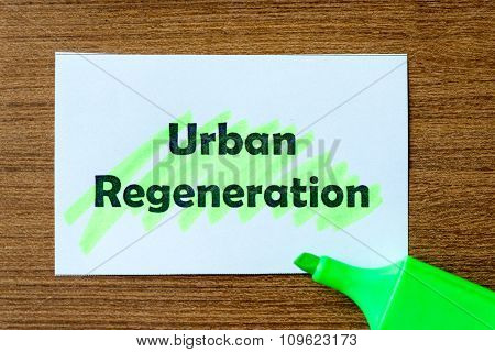 urban regeneration word highlighted on the white paper poster