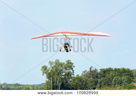 Hang Gliders Flying Above Airstrip