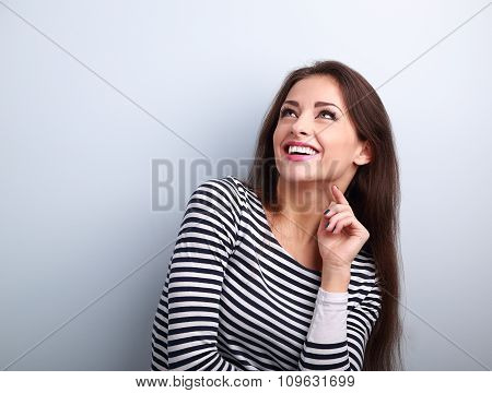 Happy Emotional Woman Thinking And Looking Up With Toothy Smiling