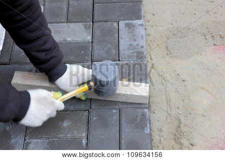 Installing Paving Slabs With A Mallet
