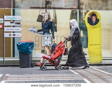 Islamic Woman With Her Child In A Buggy