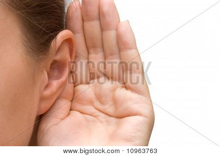 Girl listening with her hand on an ear poster