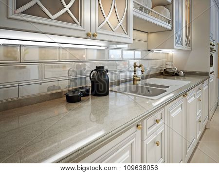 Kitchen Furniture And Marble Work Surface In A Classic Style.