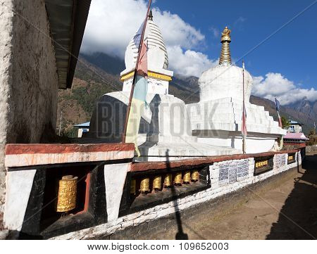 Stupa With Prayer Flags And Wheels