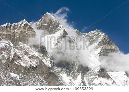 Top Of Lhotse And Nuptse With Clouds On The Top