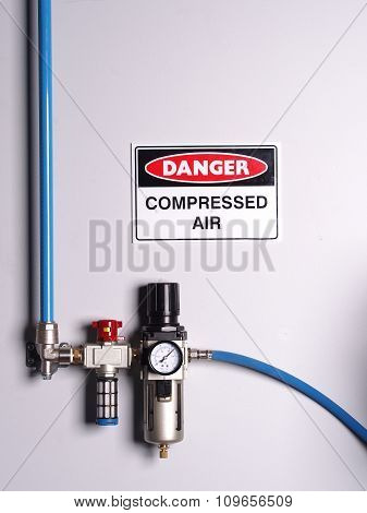 Fixed color coded compressed air line with pressure regulator, scale and flexibly hose, wall mounted poster