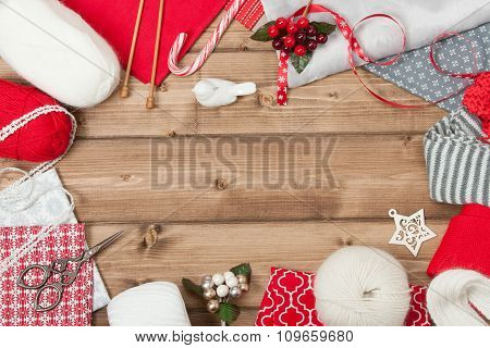Christmas Background. Knitting And Sewing Kit. Natural Wool Yarn, Linen Textile. Wooden Table With Copy Space. poster