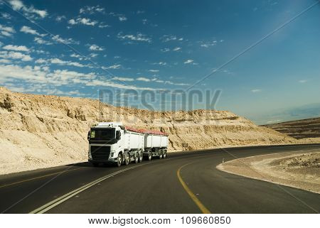 Trac driving on desert road.