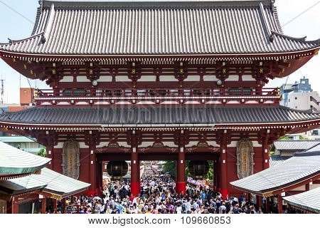 TOKYO, JAPAN - CIRCA MAY 2014: Tourists in the Senso-ji Temple in Tokyo, Japan. The Senso-ji Buddhist temple is the symbol of Asakusa and one of the most famous temples in all of Japan.