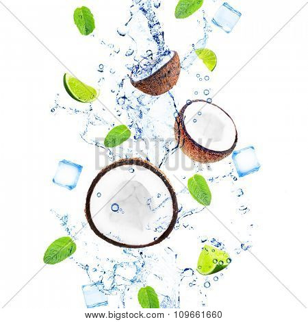 Coconuts, slices of limes with mint leaves in water splashing isolated on white