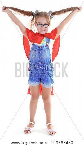 Fancy superhero girl poses on white background