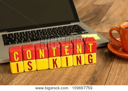 Content is King written on a wooden cube in a office desk