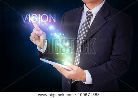 Businessman holding tablet with pressing vision. internet and networking concept