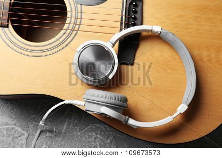 Classical guitar and headphones, close-up