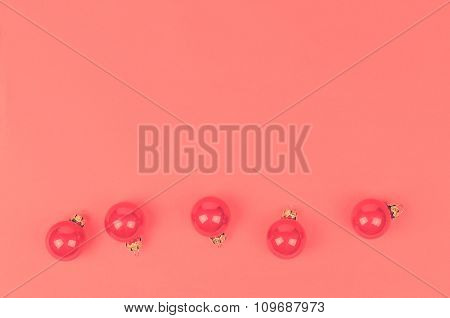 Five Christmas Balls On A Pink Background