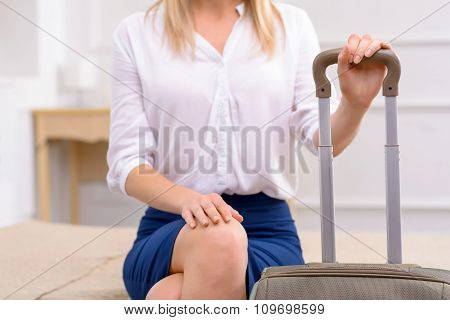 Girl  with luggage in her hotel suite.