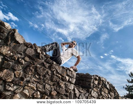 Male Posing On Stone Wall