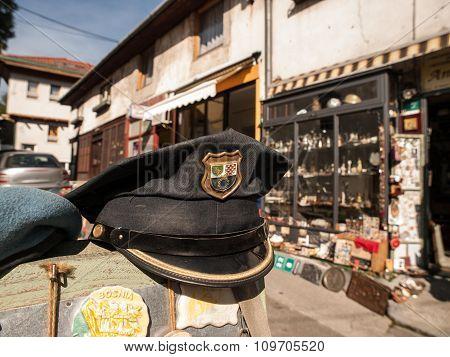Vintage Croatian police hat at antique store in Bascarsija Market Sarajevo Bosnia and Herzegovina Europe. poster