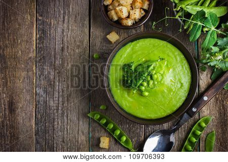Green Peas Soup On Rustic Background