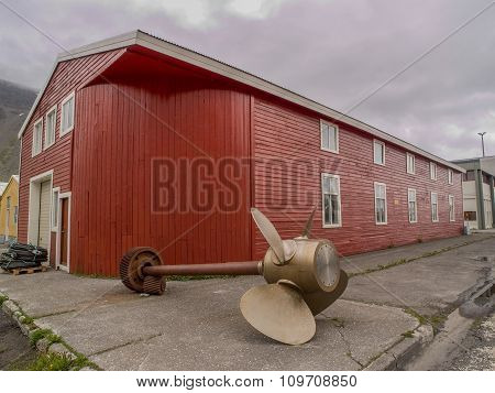 Red Building With Ship Propeller