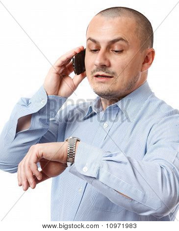 Late Businessman Looking At Watch