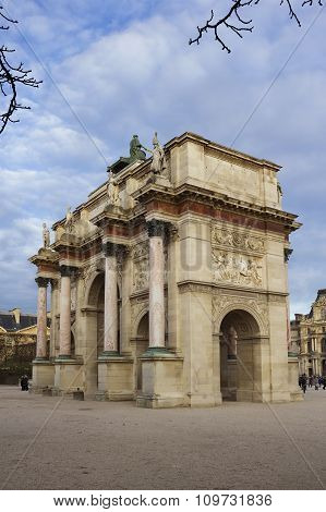 The Arc de Triomphe du Carrousel. It is a triumphal arch in Paris located in the Place du Carrousel and is derivative of the triumphal arches of the Roman Empire.