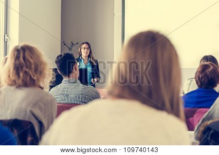 Business woman delivering a speach.