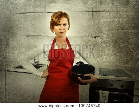 young beautiful cook woman confused and frustrated face expression wearing red apron holding cooking pot at home kitchen in domestic stress and lifestyle concept grunge dirty background edit poster