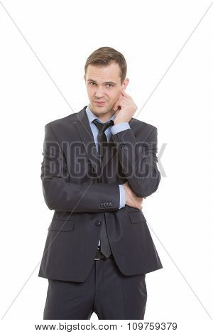 body language. man in business suit isolated white background. scratching, rubbing the ear. gesture