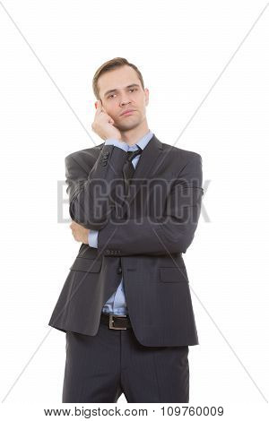 body language. man in business suit isolated on white background. Backs cheek with his fist, index f