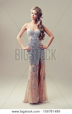 Girl model in long evening dress with rhinestones