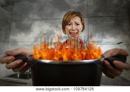 Young Inexperienced Home Cook Woman In Panic With Apron Holding Pot Burning In Flames With In Panic