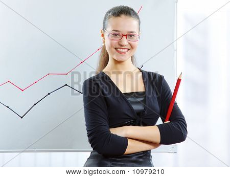 Businesswoman In Front Of The Graph