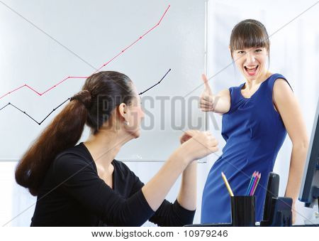 Two Businesswomen With a Graph