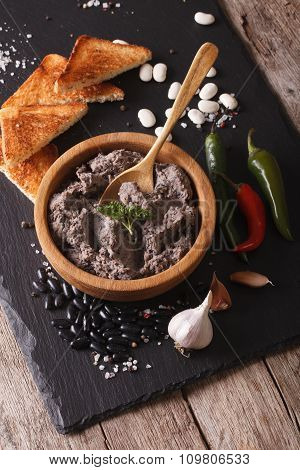 Mexican Cuisine: Frijoles Refritos With Ingredients Close-up. Vertical