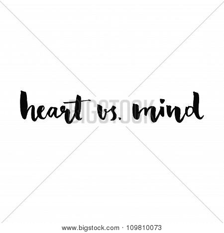 Heart vs mind. Phrase handwritten with black ink and brush, custom lettering for posters, t-shirts a
