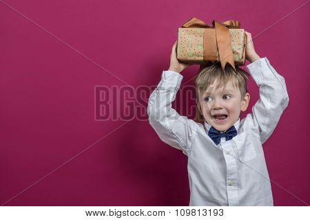 Happy Child Holding A Present